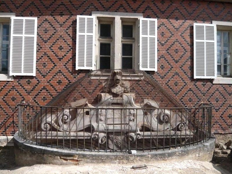 Agence Caillault ACMH – Porte de la Craffe – Nancy – Oculus sur la porte intérieur du passage voûté avant restauration